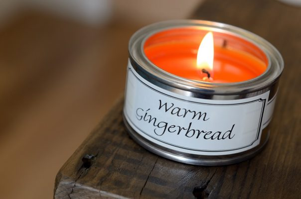 Lit Warm Gingerbread Paint Pot Candle on a Shelf