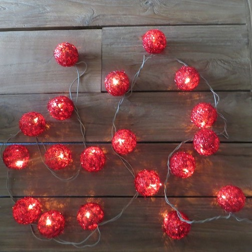 Christmas Bauble Lights Red Lit on wood background
