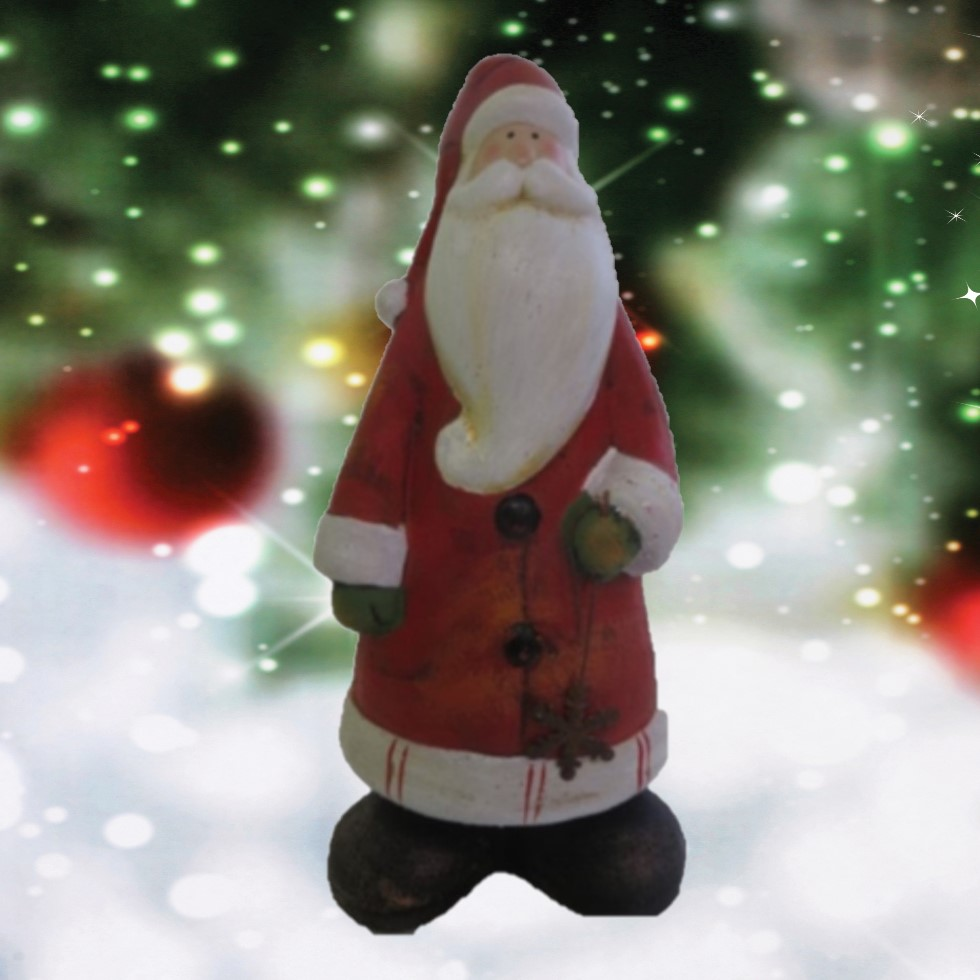 Father Christmas Ceramic Figure with a snowy Chriatmas tree background