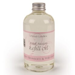 Apple Blossom and Wild Berry Reed Diffuser Refill bottle in a pink label