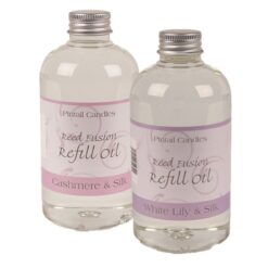 2 reeed diffuser oil bottle.s. Cashmere & Silk and White Lily & Silk in pink and purple labels